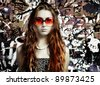 The girl in sunglasses and  beads - stock photo
