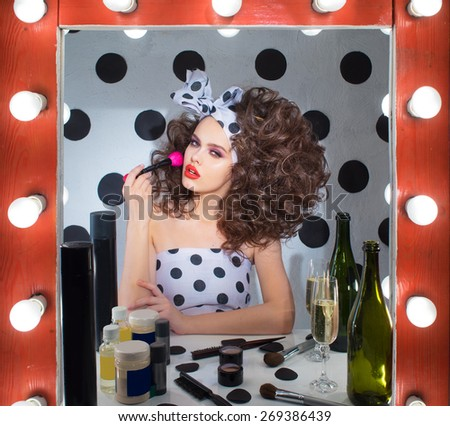 The girl in the dressing room, do yourself a makeover  - stock photo