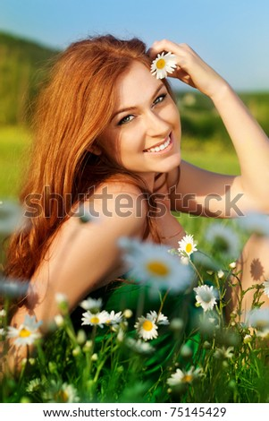 The girl in the field with camomiles - stock photo