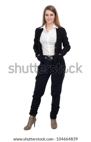 The girl in the full-length standing with his hands in his pockets - stock photo