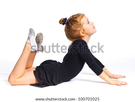 The girl in the gymnast trains. Isolated on white backround - stock photo