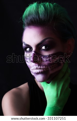 The girl in the image of a zombie. Makeup for Halloween.