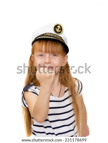 The girl in the marine cap on white background showing a fist - stock photo
