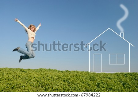The girl in white jumps in the field near the house of dream - stock photo