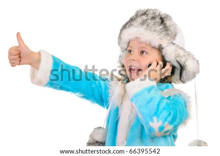 The girl in winter clothes speaks by phone and shows sign OK over white background - stock photo