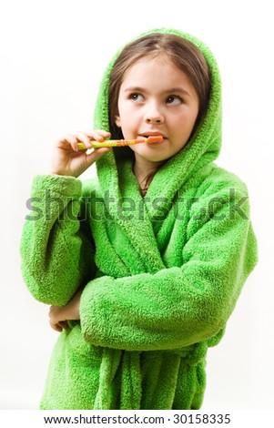 The girl is brushing teeth - stock photo