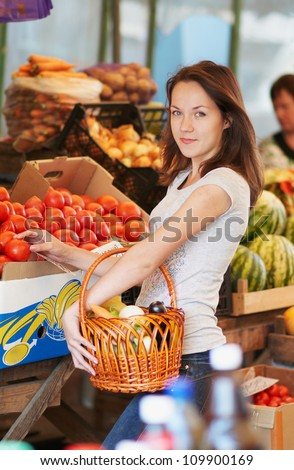 The girl is choosing the food in the market - stock photo