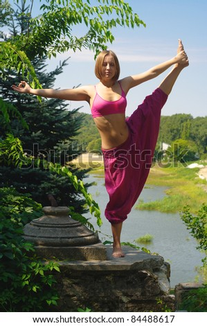 The girl is engaged in yoga - stock photo