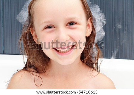 the girl is happy in the swimming bath - stock photo