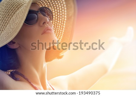 the girl is happy summer sun - stock photo