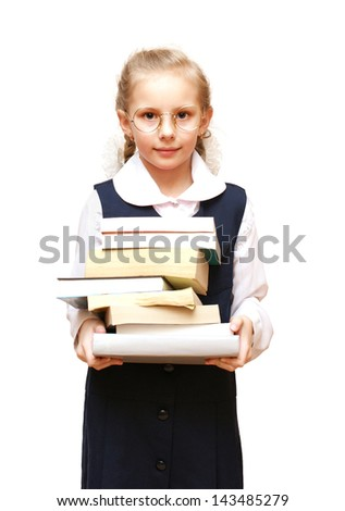 The girl is holding a round big pile of books - stock photo
