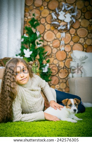 The girl is lying in the floor with the dog. Girl with dog.  - stock photo