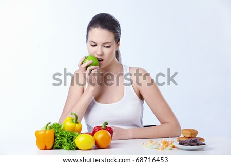 The girl is the apple and looks for dessert on a white background - stock photo