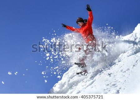 The girl jumps from a snowdrift