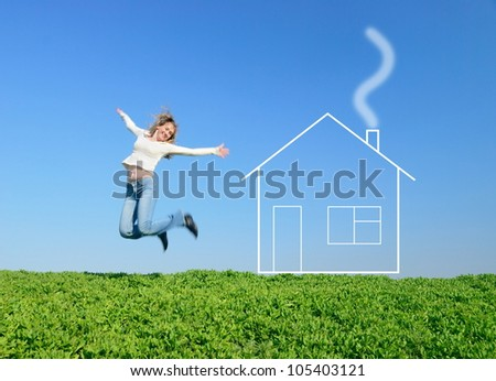 The girl jumps in the field and dreams about house - stock photo