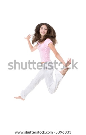 The girl jumps on a white background