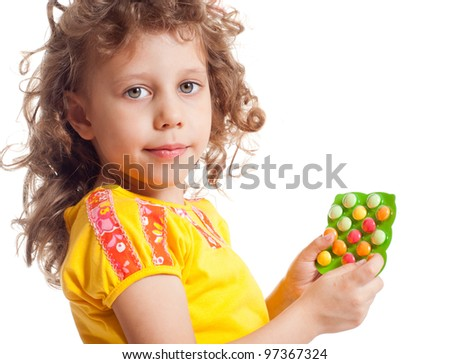 The girl keeps vitamins in packages - stock photo