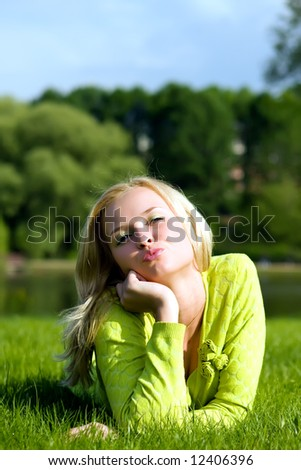 The girl lays on a grass a meadow