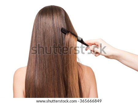 The girl long smooth hair brush, closeup isolated on white background