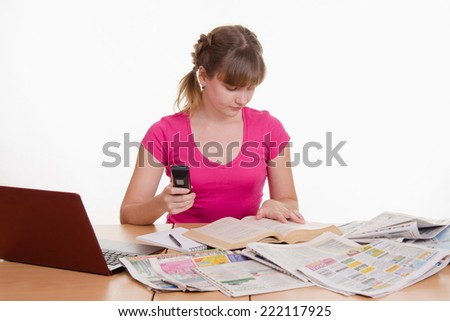 The girl looks in the directory - stock photo