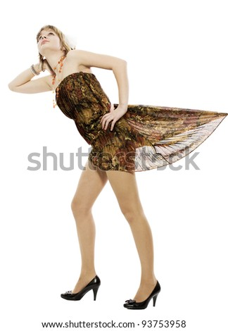 The girl looks upwards, the dress hem rises - stock photo