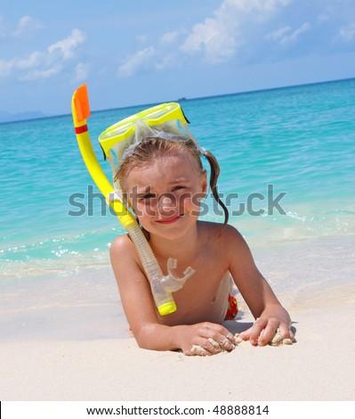The girl lying on seacoast - stock photo