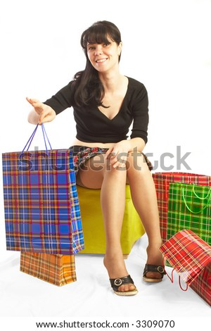 The girl makes purchases. A white background.