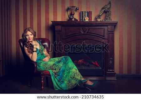 The girl near a fireplace at home - stock photo