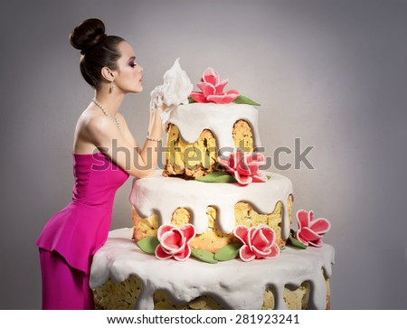 The girl near a huge birthday cake - stock photo