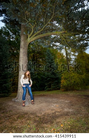 The girl near a tree in autumn