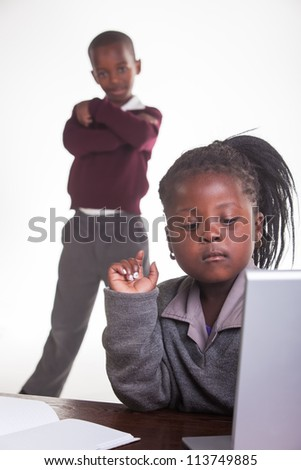 The girl need some help with the computer. - stock photo