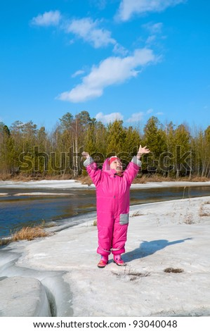The girl of three years rejoices to approach of spring - stock photo