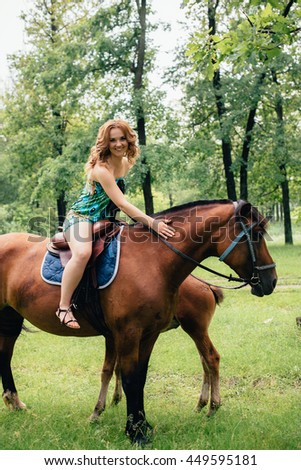 The girl on a horse in the park