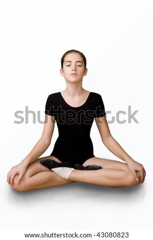 The girl on a white background. Exercise yoga - stock photo