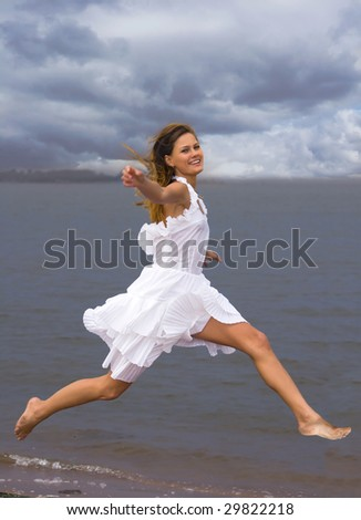 The girl on coast of a gulf - stock photo