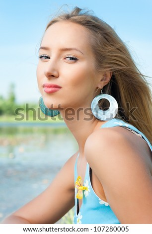 The girl on the bank of the river, the summer - stock photo