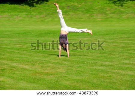 The girl on the field - stock photo