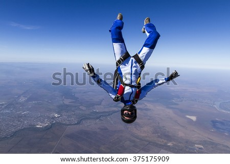 The girl parachutist in free fall.