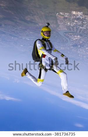 The girl parachutist in free style. - stock photo