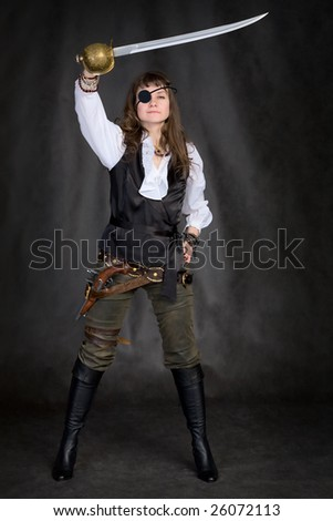 The girl - pirate with a sabre in hands and eye patch on face