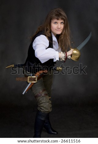 The girl - pirate with a sabre in hands on a black background