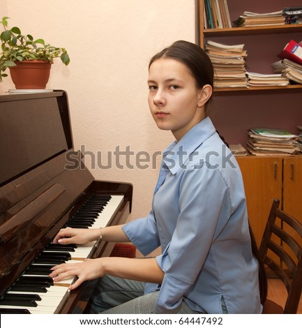 The girl playing the piano at the music school's office
