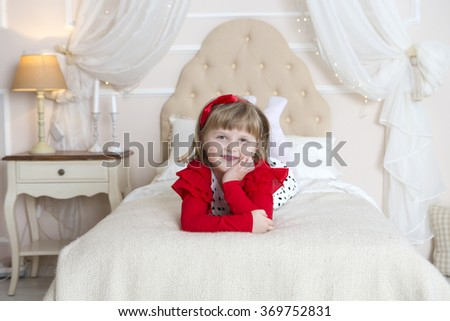 the girl plays in a nursery - stock photo