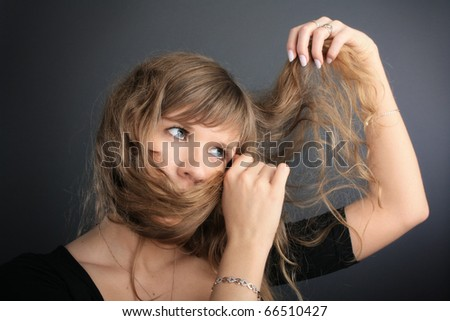 The girl plays with the hair