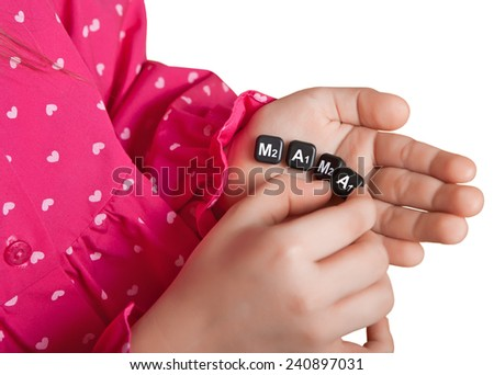 The girl puts on the palm of chips the word mother. Isolated on a white background. - stock photo