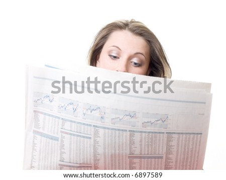 The girl reads exchange reports in the newspaper