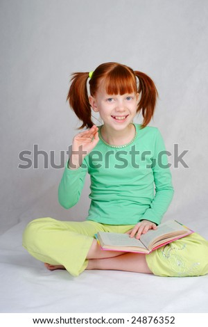 The girl reads the book - stock photo