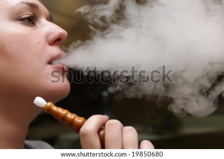 The girl relaxes with hookah  in the evening - stock photo