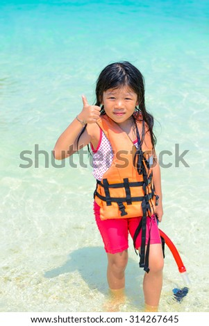 The girl relaxing, Shooting photo on the beach in summer vacation at Khai Nok island, Phang Nga, Thailand - stock photo