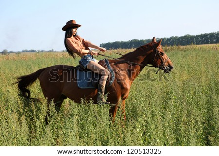 the girl rider walking his horse